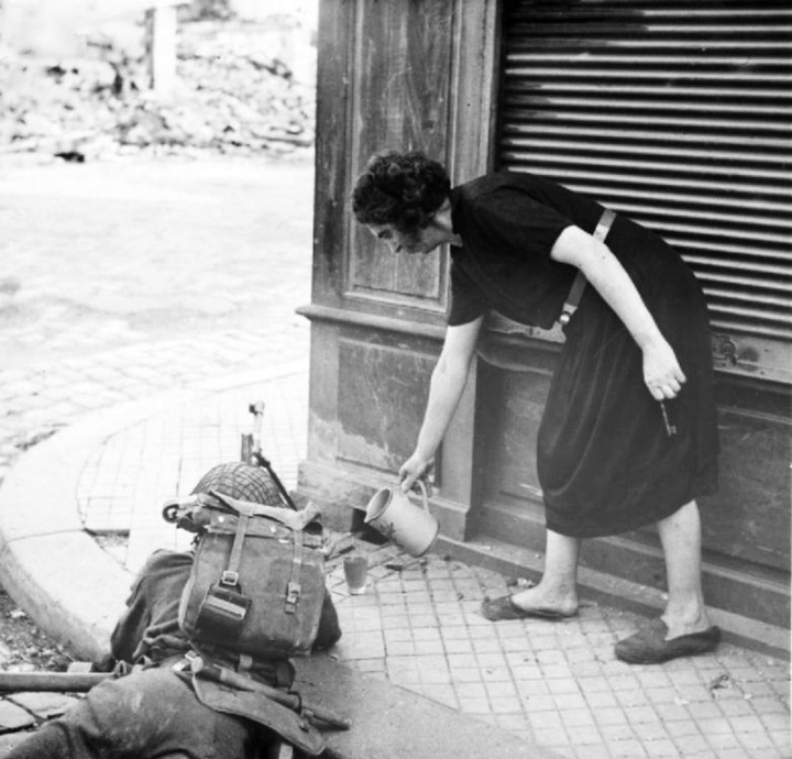 French woman pours cider for a British soldier
